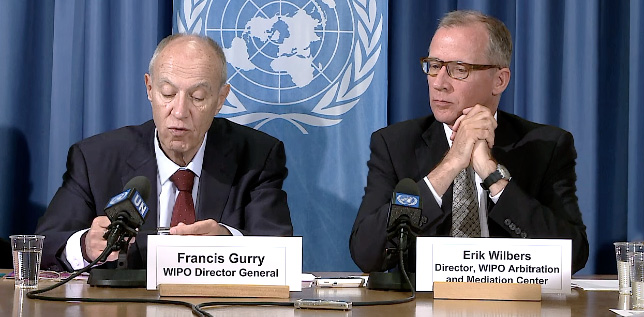 WIPO Director General Francis Gurry and Director of WIPO Arbitration and Mediation Center Erik Wilbers discussing WIPO domain name dispute resolution cases in 2015 during a press conference at the United Nations Office in Geneva.