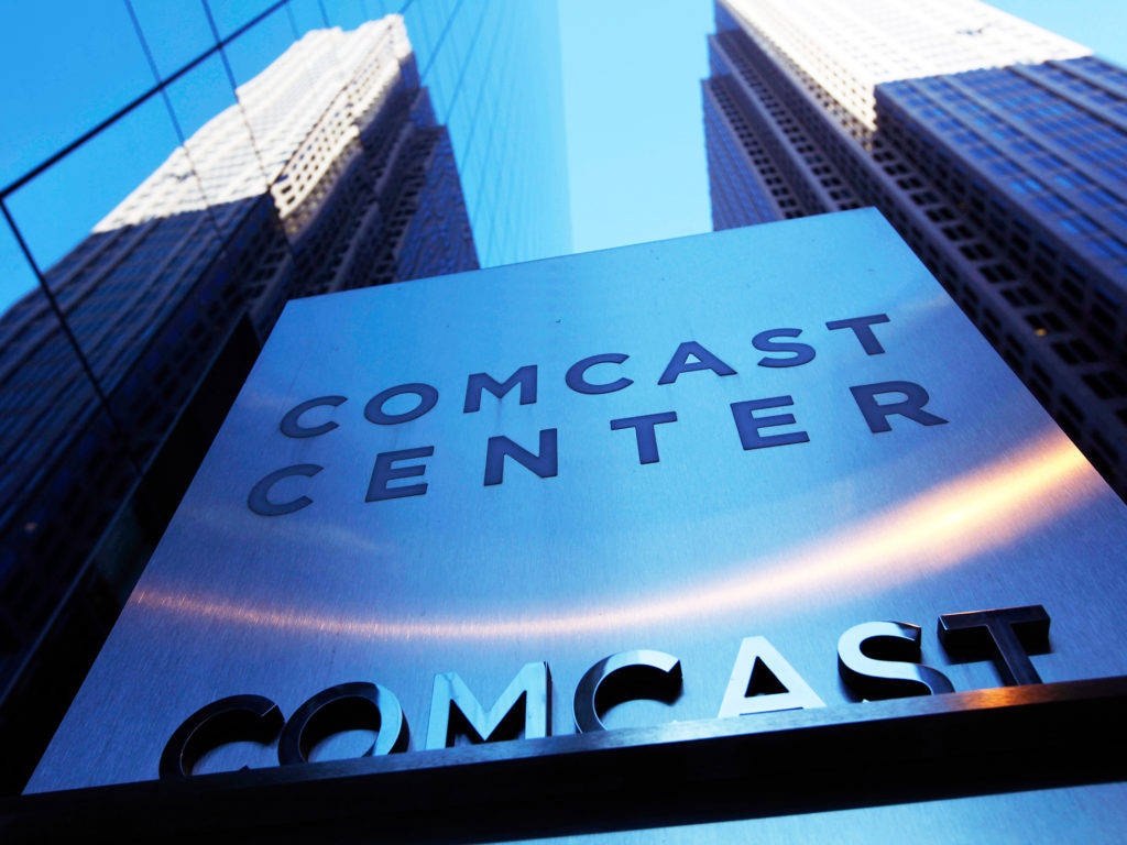 "FILE - In this Dec. 3, 2009 file photo, a sign outside the Comcast Center is seen in Philadelphia. A federal appeals court has upheld the government's ""net neutrality"" rules that require internet providers to treat all web traffic equally. Providers like Comcast, Verizon and AT&T say the rules threaten innovation and undermine investment in broadband infrastructure. (AP Photo/Matt Rourke, File)"